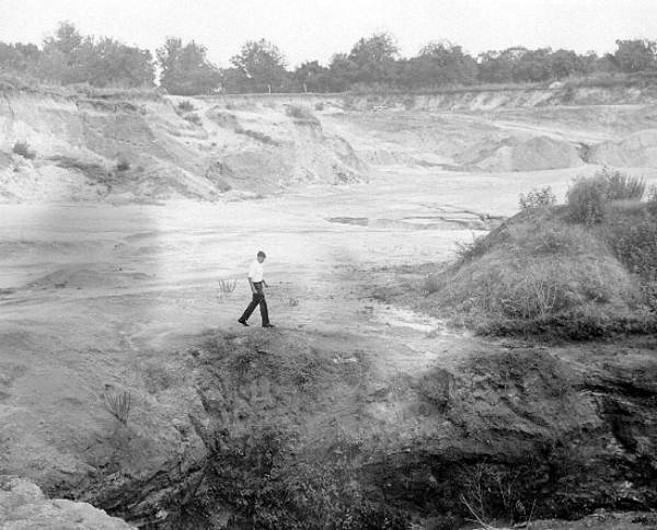 PHOTO: State Archives of Florida /Man walking a large sinkhole