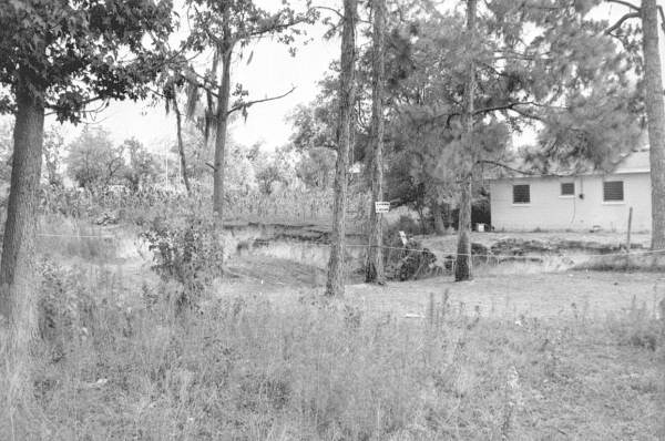 PHOTO: State Archives of Florida /View of sinkhole and house by Reves William D. 1963