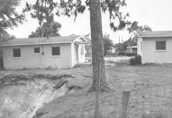 PHOTO: State Archives of Florida /sinkhole, house and fracture trace by Reves, William D. 1963